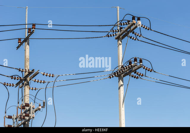 Electric Pole Connect High Voltage Wires On Blue Sky Background