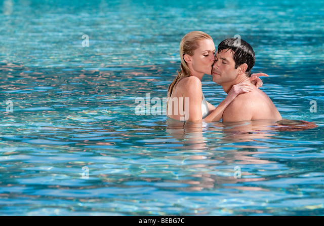 Young Couple Kiss Swimming Pool Stock Photos Young Couple Kiss Swimming Pool Stock Images Alamy