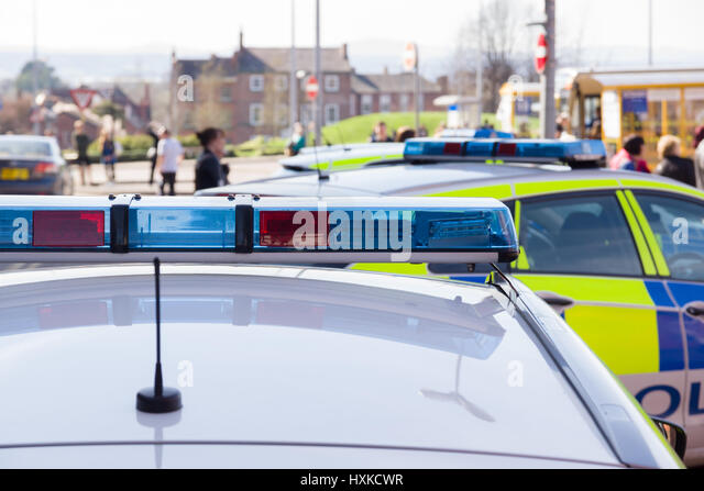 Police car uk blue light stock photos police car uk blue light light bars on unidentified british police vehicles attending an incident in a busy town or city aloadofball Choice Image
