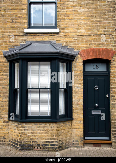 Traditional English house front entrance with black closed doors and windows - Stock Image & British Front Doors Stock Photos \u0026 British Front Doors Stock Images ...