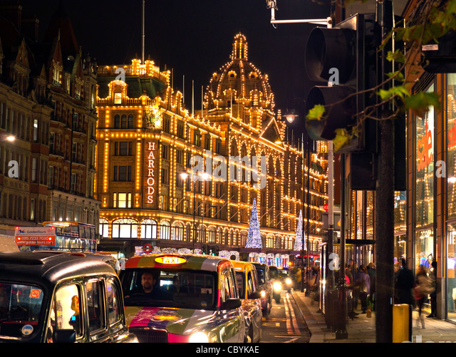 harrods department store with christmas lights at dusk with taxi cabs waiting in lineknightsbridge - Christmas Lights Store