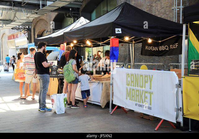 Artisan street food on sale at the Kings Cross Canopy Market in the historic West & West Handyside Canopy Stock Photos u0026 West Handyside Canopy Stock ...