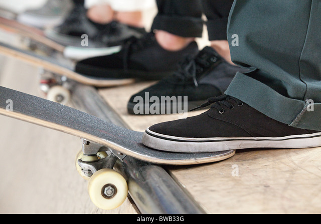 Skateboarders lick shoes
