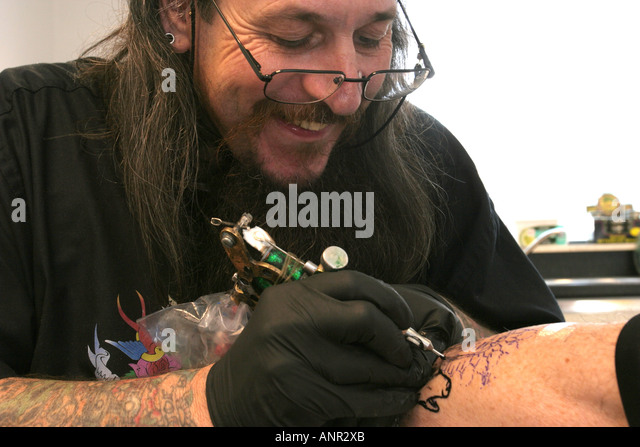 Tatooing stock photos tatooing stock images alamy for How to become a tattoo artist in india