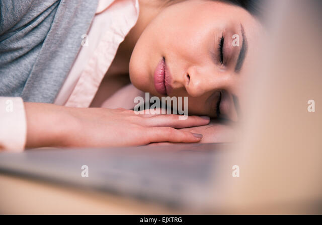 beautiful business woman sleeping on the table in office stock image business nap office relieve