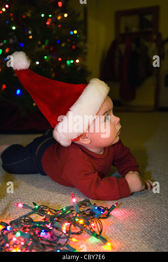 Christmas Lights String House Stock Photos Christmas Lights  - Baby With Christmas Lights