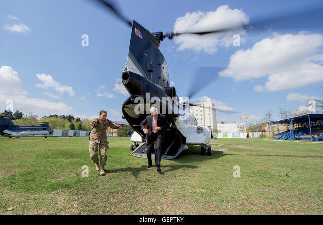Secretary Kerry Disembarks From Helicopter Upon Arrival At Camp Resolute Support Landing Zone In Kabul