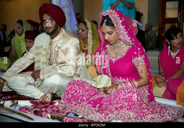 A Sikh Wedding Ceremony In England Bride Is Holding The Palla Bonding Her To