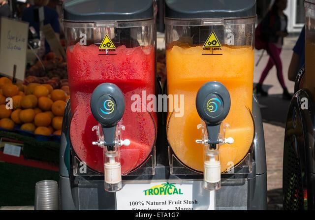 cold refreshing strawberry and mango fruit slush drink machines stock image - Slushie Machines