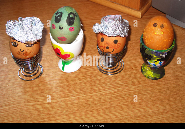 Decorated boiled egg stock photos decorated boiled egg stock painted decorated hard boiled easter eggs in cups stock image ccuart Gallery