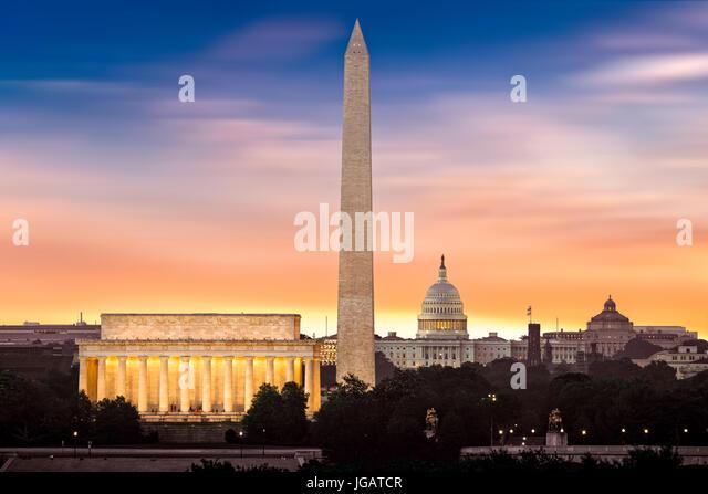 New Dawn over Washington - with 3 iconic monuments illuminated at sunrise: Lincoln Memorial, Washington Monument - Stock Image
