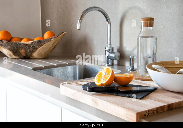 Modern Kitchen Sink With Cutting Board   Stock Image