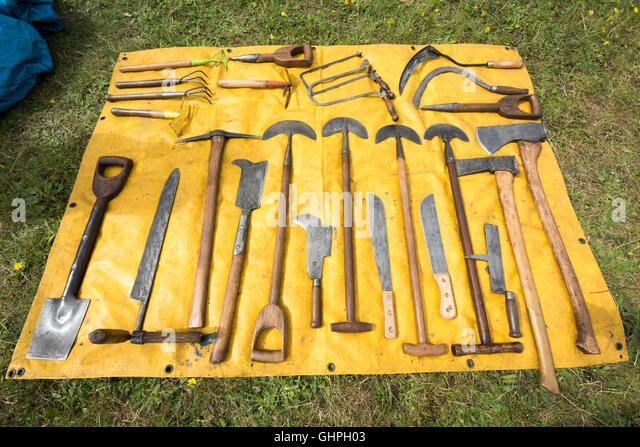 Antique Gardening Tools Laid Out On A Yellow Sheet For Sale At A Car Boot  Sale