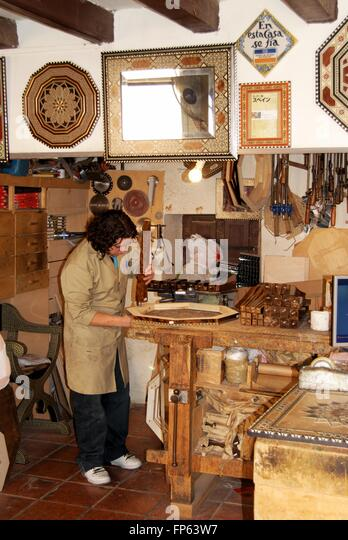 A Carpenter Making Moroccan Style Furniture Inside A Workshop, Palace Of  Alhambra, Granada,