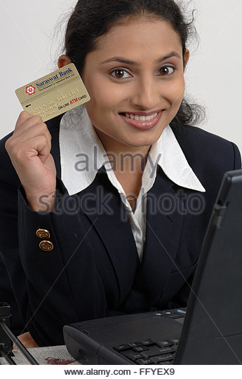 Indian lady showing credit card stock photos indian lady showing office going south asian indian lady showing credit card laptop on desk mr 670v reheart Choice Image