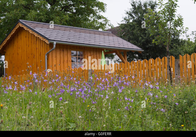 Garden House With An Enclosed Garden, In Front Of Bell Flower Meadow    Stock Image