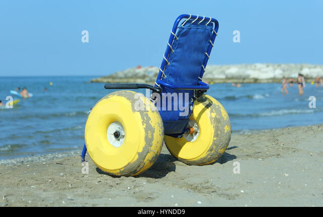 Special wheelchair with inflatable wheels to go in the sea and on the beach  - Stock