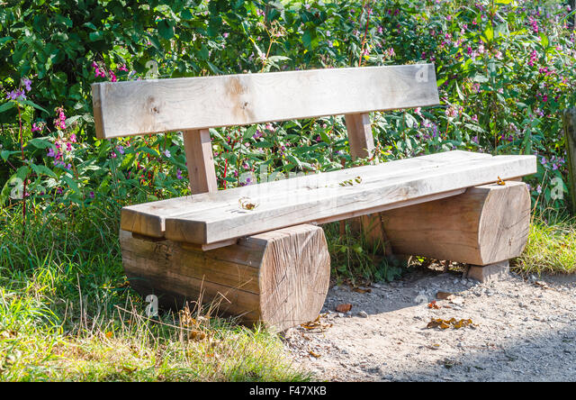Park bench made wood in stock photos park bench made for Tree trunk garden bench