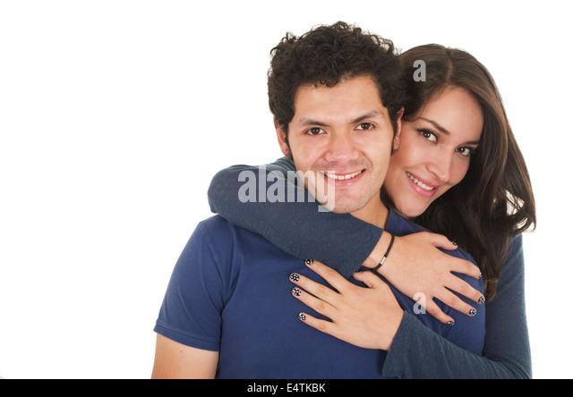 hispanic young couple hugging - Stock Image