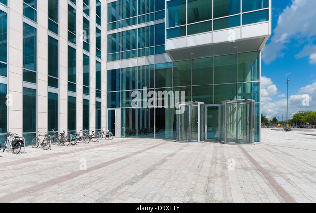 office entrance doors. entrance of a modern office building with revolving doors stock image