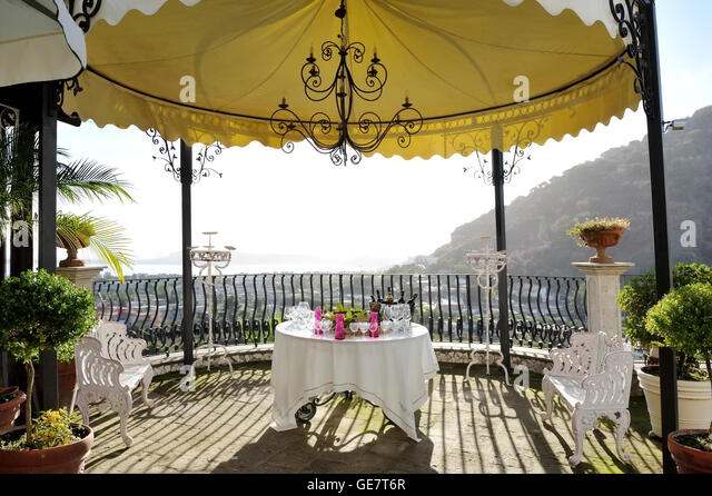 Table With Wine Bottles And Glasses Under A Gazebo