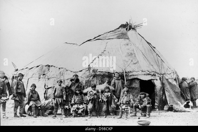 Native American men and children standing in front of a large tent structure; women stand & Native american Tent Stock Photos u0026 Native american Tent Stock ...