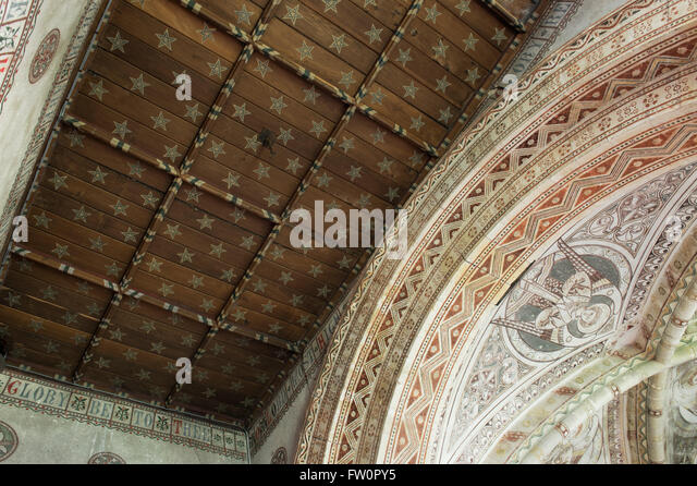Wooden star ceiling and wall stenciling in the chancel at st georges