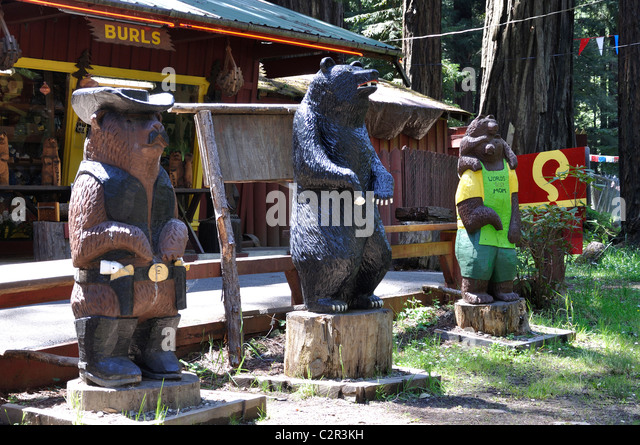 Carved wooden bears stock photos