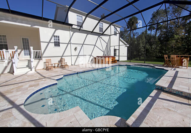 a swimming pool and hot tub at a large home stock image