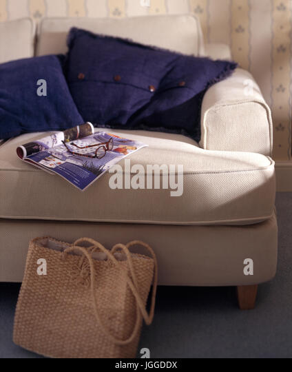 Closeup Of Large Upholstered Easy Chair With Cushions And Magazine   Stock  Image