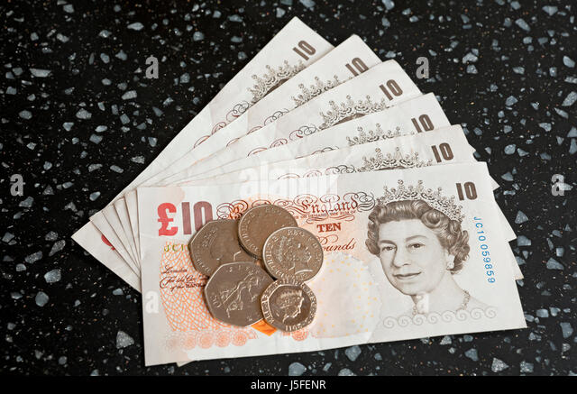 English ten pound notes and coins England UK United Kingdom GB Great Britain - Stock Image
