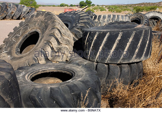 Tyres stacked stock photos tyres stacked stock images for Old tyre uses