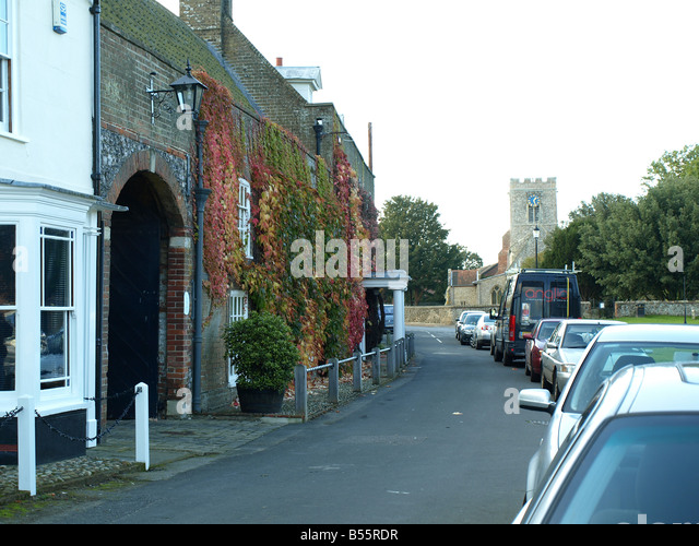Ivy Covered Houses,street And Church At Burnham Market,Norfolk,East Anglia,