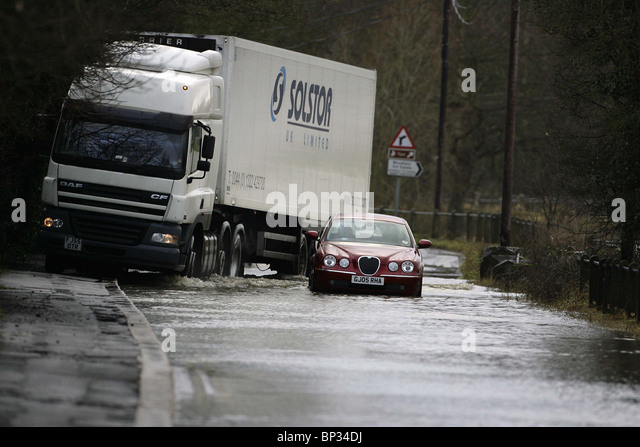 A Car Tries To Negotiate Flooded Road In Yalding KentPicture By James