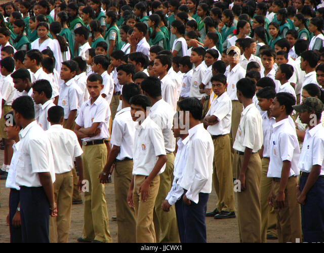 Indian school children gathered on a ground for a function - Stock Image