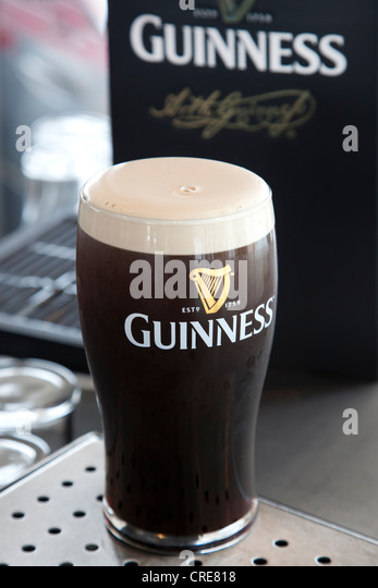 Guinness and glass stock photos guinness and glass stock for Guinness beer in ireland