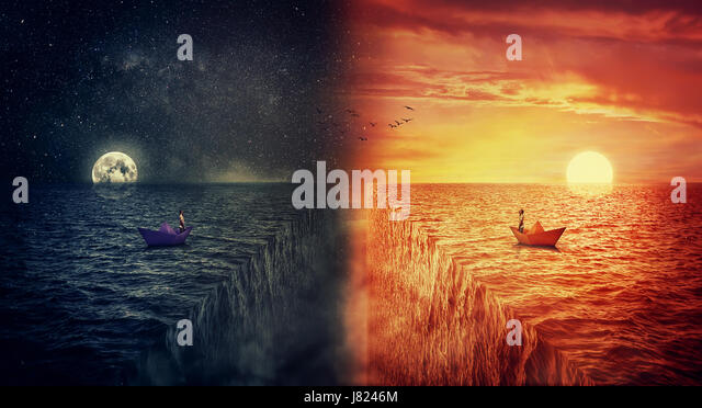 Conceptual view of two worlds collide, as a lost man, in a paper boat, sailing in the middle of the ocean try to - Stock Image