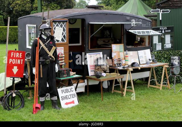Beaulieu, Hampshire, UK - May 29 2017: Display of WW2 Air Raid Patrol (ARP) memorabilia, including gas masks and - Stock Image