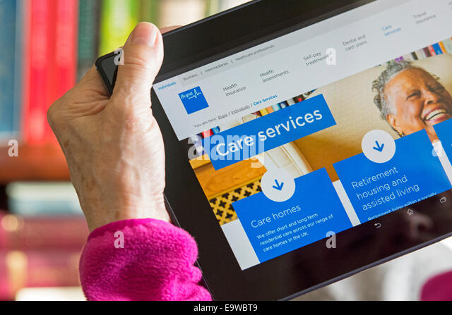 Care Home Services Screen On Bupa Website Woman Reading Browsing Web Site For