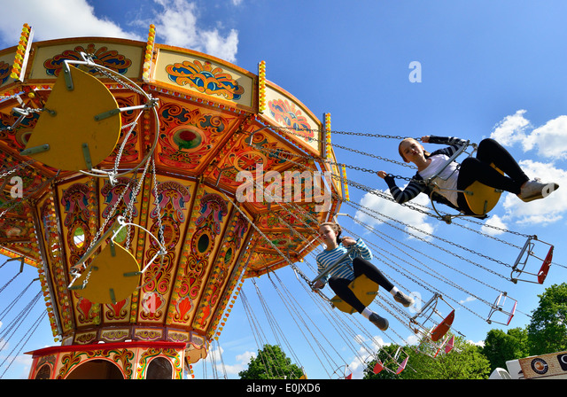Girls Taking A Ride On The Swing Carousel At Royal Windsor Horse Show