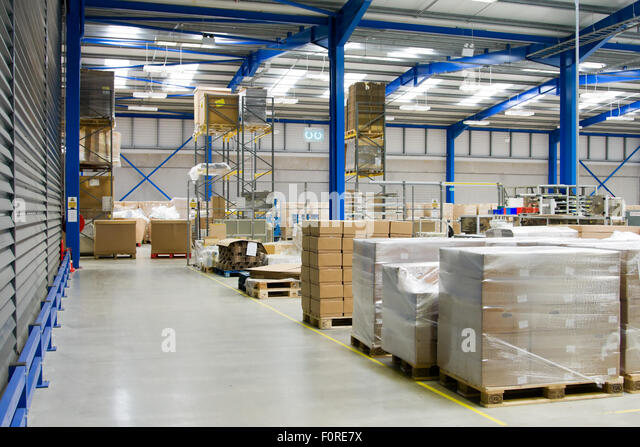 Industrial Warehouse Interior And Pallets With Cardboard Cartons   Stock  Image