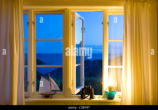 View Of The Scenic Sea Through Yellow Windows   Stock Image