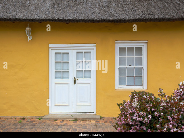 The Front Entrance To A Traditional Thatched Cottage In The Town Of  Greyton, In The