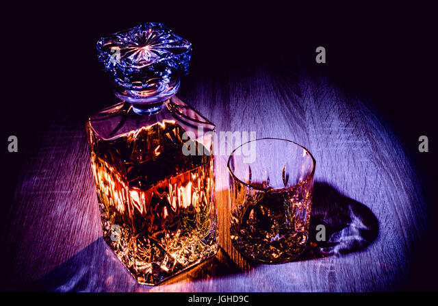 Whiskey in a decanter with some lightpainting - Stock Image
