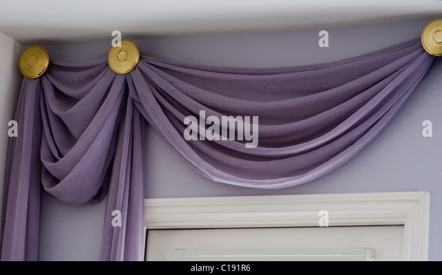 hanging drapery panels over a door with a high ceiling stock image - Hanging Drapery
