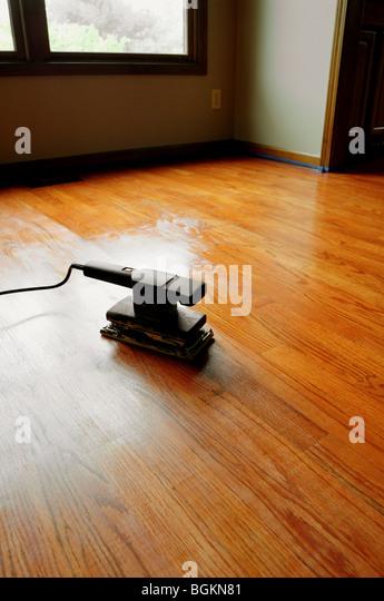 Random Orbital Electric Sander And A Hardwood Floor Refinishing Project    Stock Image