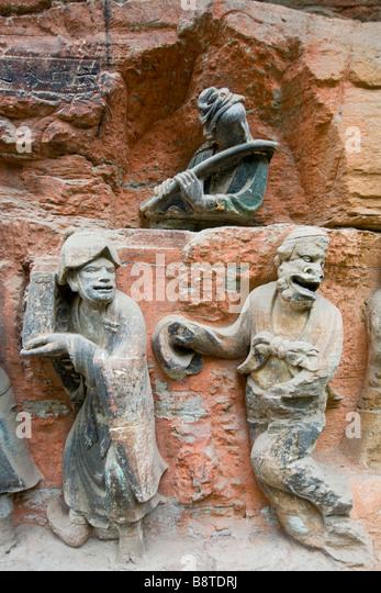 Buddhist cave carvings dazu sichuan stock photos