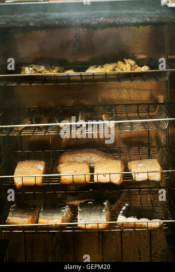 Salmon smoking house stock photos salmon smoking house for Racks fish house