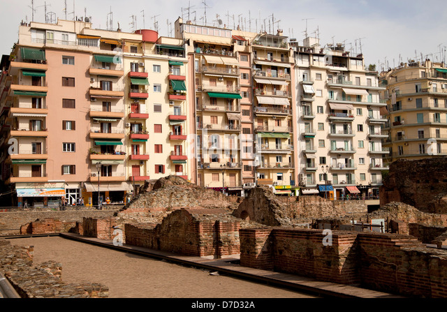 roman excavations and apartment buildings in thessaloniki macedonia greece stock image - Rome Apartments