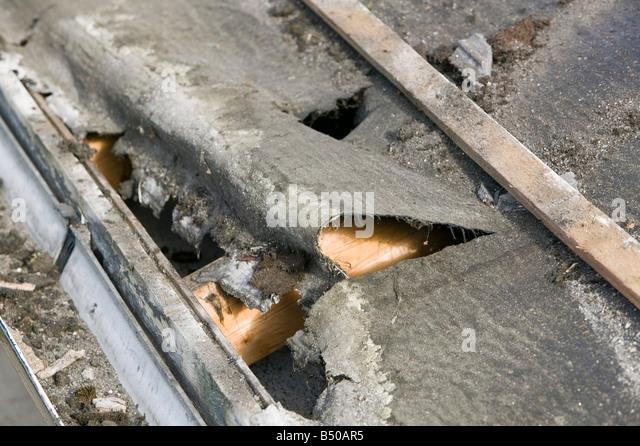 Guttering repair stock photos guttering repair stock for Leaking roof gutter